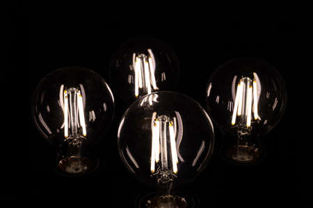 incandescent bulbs on black background