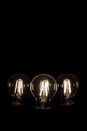 incandescent bulbs on black background with copy space