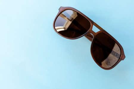 sunglasses on a light blue background, copy space 免版税图像