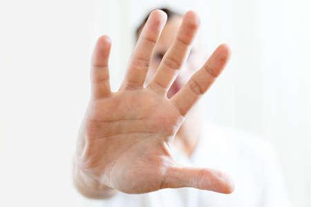 open male palm stop symbol on light background 免版税图像