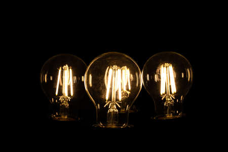 close up of incandescent bulbs on black background