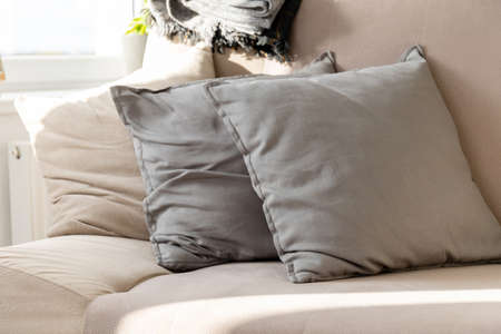 pillows stacked on the couch