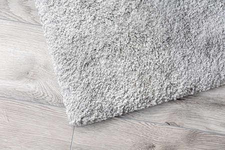 gray home carpet on parquet floor 免版税图像
