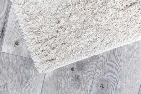 white home carpet on parquet floor 免版税图像