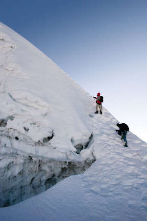 sherpa: Two climbers about to summit Island Peak in Nepal. The peak is very close to Everest and Lhotse. This picture was taken in in the middle of October at 6:45am.