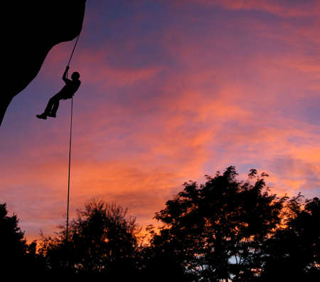 abseil: Rappelling at dusk in Montana. Stock Photo
