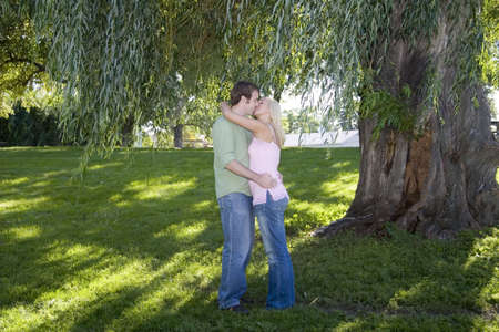 Young romantic couple at the park photo