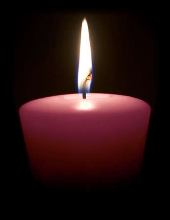 yankee: Isolated candle on a black background.