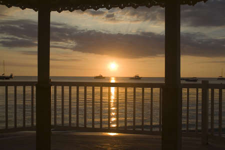 A Jamaican sunset from a romantic gazebo  photo