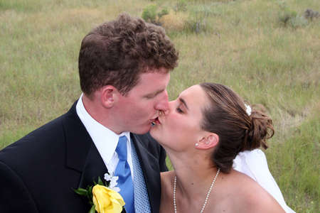 Newly weds moving in for a kiss photo