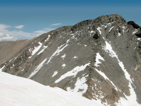 The snow covered saddle between Tempest Mountain and Granite Peak photo
