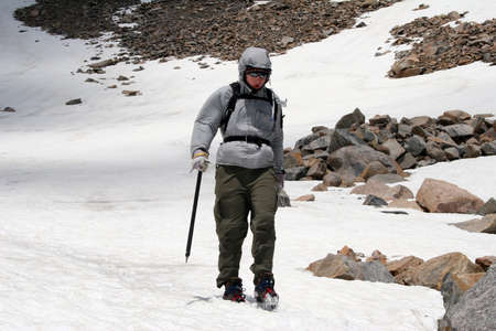 Descending down an alpine glacier. Stock Photo