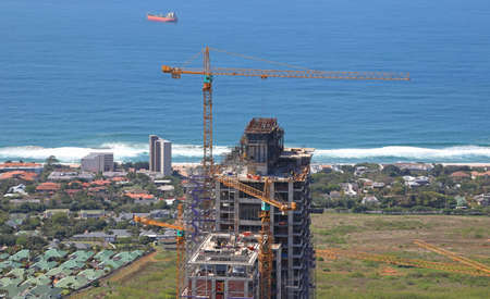 Durban, KwaZulu Natal / South Africa - 09/26/2019: Aerial photo of tower cranes on a construction site