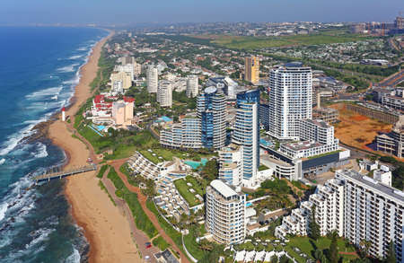 Durban, KwaZulu-Natal / South Africa - 04/29/2019: Aerial photo of a Umhlanga lighthouse and beachfront with Durban in the background Editorial