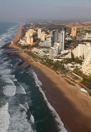 Durban, Kwa-Zulu Natal / South Africa - 06/12/2010: Aerial photo of Umhlanga beachfront and lighthouse with Durban in the background