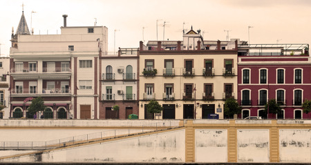 Facades of old houses in various colors in Seville