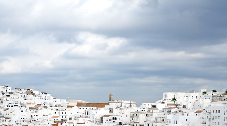 Architectural complex consisting of white houses next to each other on top of a mountain
