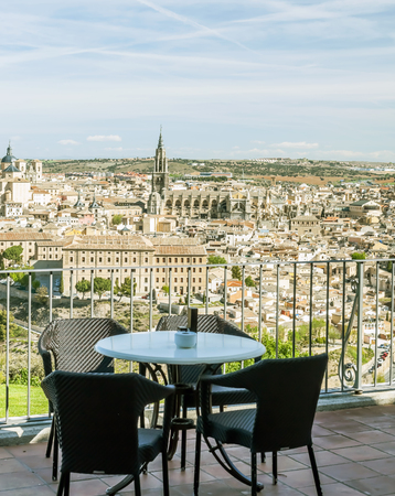 View of the Spanish city of Toledo, seen from the Gothic cathedral of Santa Maria and the alcazar, in a structure of medieval city