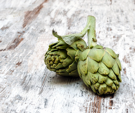 Artichokes surrounded by rustic background
