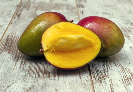 Mangoes surrounded by rustic background
