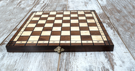 Chess pieces on a wooden board