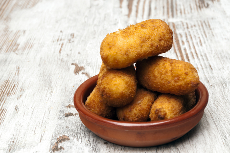 Croquettes surrounded by rustic background