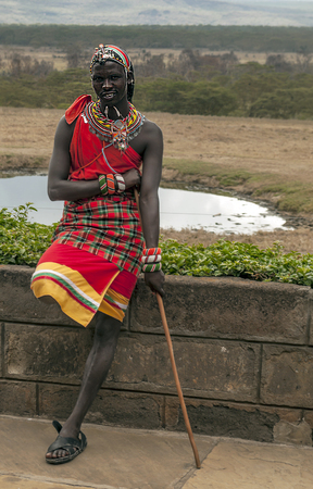 MASAI MARA,KENYA-MAY 14:portrait on an African man of Masai Mara tribe village smiling to camera e,review of daily life of local people,near Masai Mara National Park