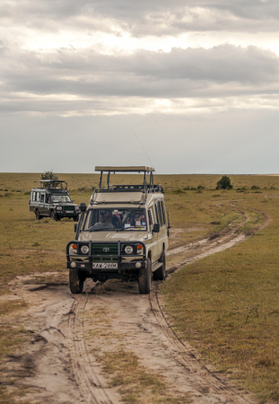 AMBOSELI, Kenya - MAY 2014. Tourist in jeep safari in the road of National Park of Kenya. They are traying see animals. Editorial
