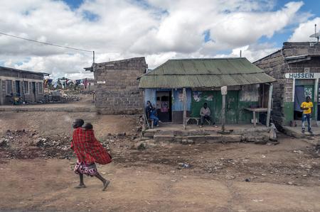 NAIVASHA, KENYA - MAY, 2014: Typical shopping street scene with pedestrians in Naivasha, Kenya