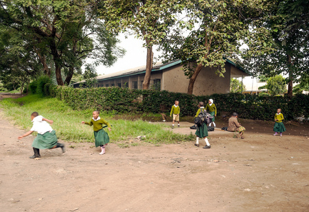 ARUSHA, TANZANIA - MAY 2014. Group of children in Africa face poor life conditions and health issues. However, they are curious, joyful and eager to play. Stock Photo - 114453578
