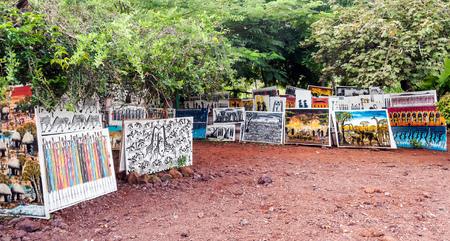 ARUSHA, TANZANIA - MAY, 2014: Typical shopping art street scene without pedestrians in Arusha, Tanzania Редакционное