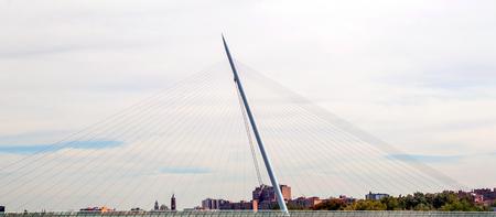 Steel of a bridge around a cloudy sky