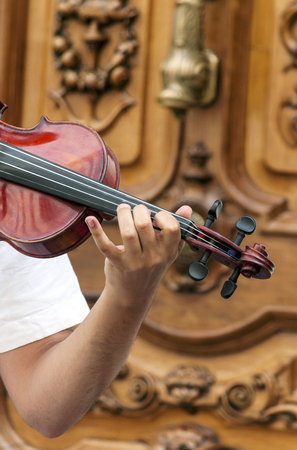 Man's hand playing the violin