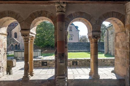 Arches of a Romanesque stone church Stock Photo