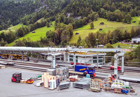 LAUTERBRUNNEN, BERNE-SEPTEMBER 2014. Train station in Lauterbrunnen in Switzerland on a cloudy day in the mountains of Switzerland. You see people around the tracks.