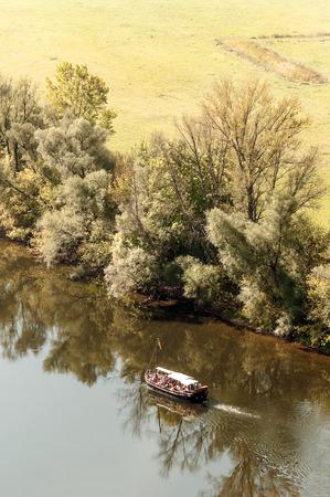 AQUITANIA, FRANCE-SEPTEMBER 2014. Boat sailing on the shore of the lake