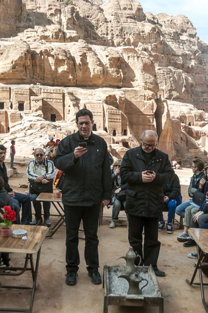 PETRA, JORDAN-FEBRUARY 2015. Tourists in Petra in Jordan .. Petra is an important archaeological site in Jordan, and the capital of the ancient Nabatean kingdom, whose inhabitants called it Raqmu. Petra is not a city built with stone but, literally, excav Editorial