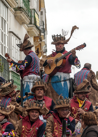 CADIZ, ANDALUSIA, SPAIN-FEBRUARY 2015. Anonymous people disguised singing in the Carnival of Cadiz, Spain.