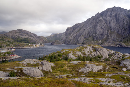 Mountains by the sea in Lofoten, Norway on a cloudy day Stock Photo