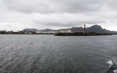 Port of Bodo on a cloudy day. Bodø is a municipality and a city of Norway, capital of the province of Nordland and the second most populated town in the Nord-Norge region, with 50 185 inhabitants in its municipality in 2015. Bodø is situated north of the polar circle Arctic and has midnight sun from June 4 to July 8 Stock fotó