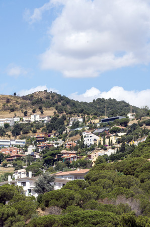 Village of Alella. Alella is a municipality of Catalonia. Belonging to the province of Barcelona, in the Maresme region. The town is located in a mountainous area, about 2 kilometers from the sea and about 18 kilometers from Barcelona.