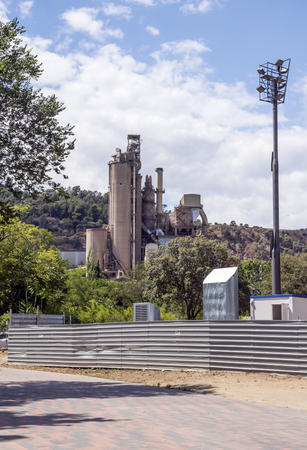 Cement factory in the mountains of Barcelona, Spain on a sunny day