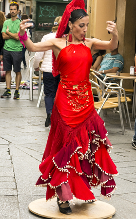 Cadiz, Andalusia, Spain-Octuber 2017. Woman dancing flamenco outdoors in the streets of Cadiz. Cadiz is a city and municipality of Spain, capital of the homonymous province, in the autonomous community of Andalusia. With 118 048 inhabitants registered in