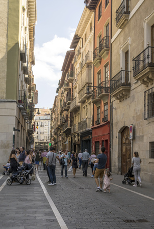 Pamplona, Navarra, Spain-September 2018. Streets of Pamplona in Navarre with people walking and buildings on both sides. Pamplona, capital of the province of Navarra, is a city in northern Spain. It is known mainly for the celebration of bullfights (feast 에디토리얼