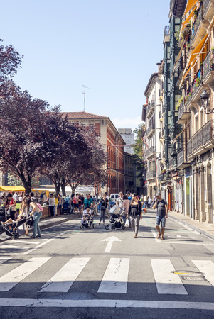 Pamplona, Navarra, Spain-September 2018. Streets of Pamplona in Navarre with people walking and buildings on both sides. Pamplona, capital of the province of Navarra, is a city in northern Spain. It is known mainly for the celebration of bullfights (feast Editorial