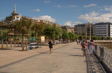 SAN SEBASTIAN, SPAIN - SEPTEMBER 2018. Streets next to the beach of La Concha in San Sebastian with people walking in them.