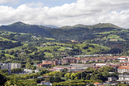 Zarautz in the Basque Country, Spain, on a sunny day with the mountains in the background Stock Photo