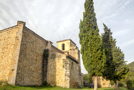 Facade of romaneque church in the north of Spain in rural town.