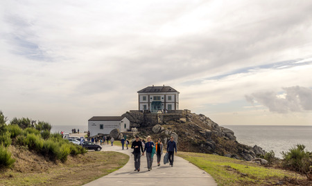 Finisterre, Spain-Octuber 2018. Pilgrims at the end of the Camino de Santiago on a cloudy day