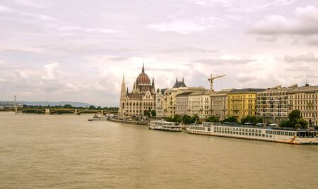 Building near the Danubio river in Budapest in a cloudy day. Stok Fotoğraf